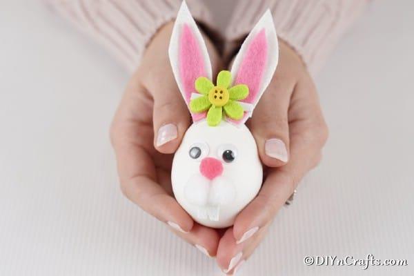 Easter egg bunny in hands