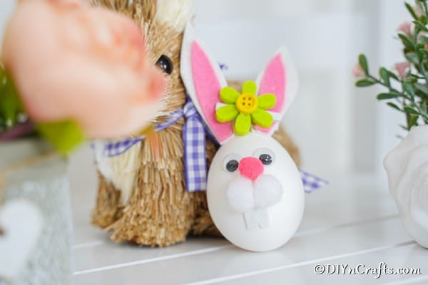Easter bunny egg leaning against stuffed bunny