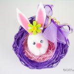 Easter egg bunny in purple wreath