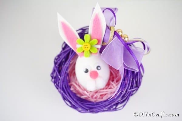 Easter egg bunny in purple wreath