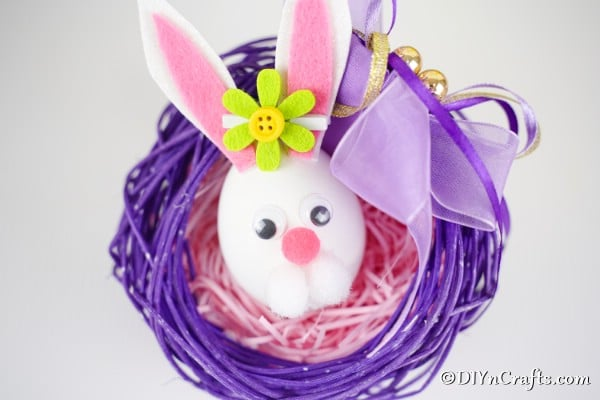 Easter egg bunny inside a purple twig wreath