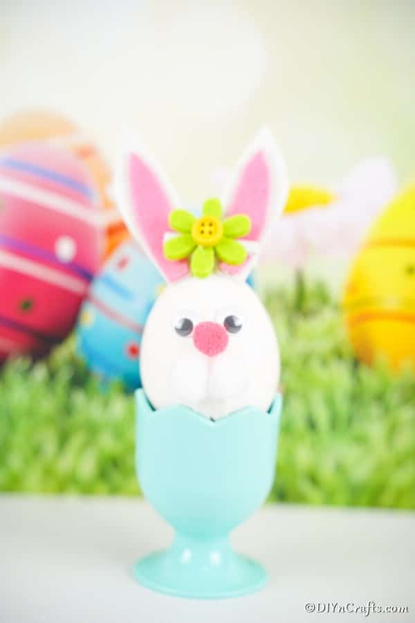 Easter egg bunny in blue egg cup