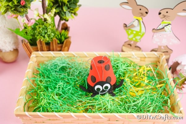 Ladybug flower pot in planter with fake grass