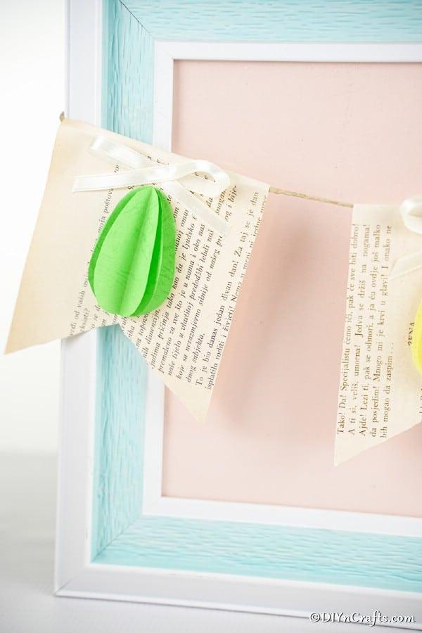 Easter egg paper bunting on blue frame