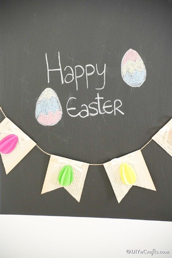 3D Easter Egg garland hanging on chalkboard