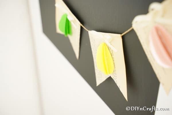 Easter egg garland hanging on chalkboard