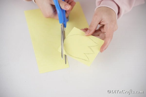 Cutting tulip shape from yellow paper