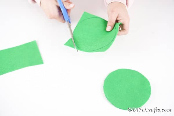 Cutting out green circles of paper