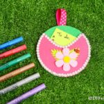 Pocket wall organizer on grass with markers