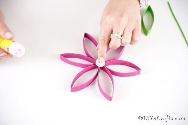 Adding button to center of paper roll flower