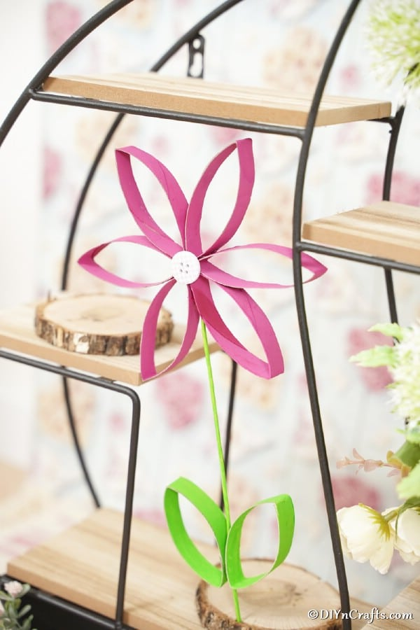 Toilet paper roll flower on wooden shelf