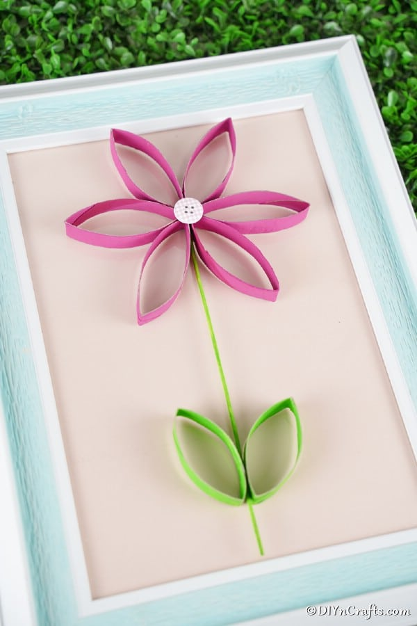 Paper roll flower on picture frame