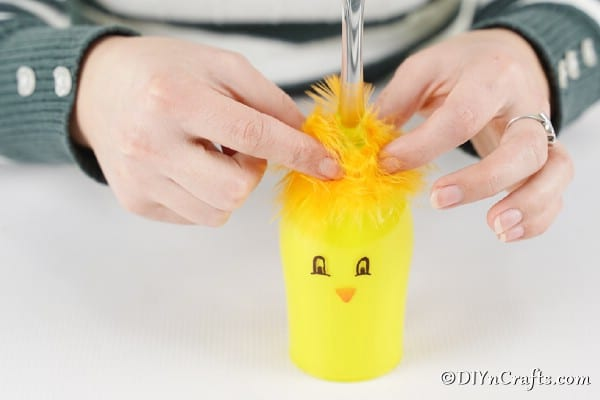 Gluing feathers on top of chicken wine glass