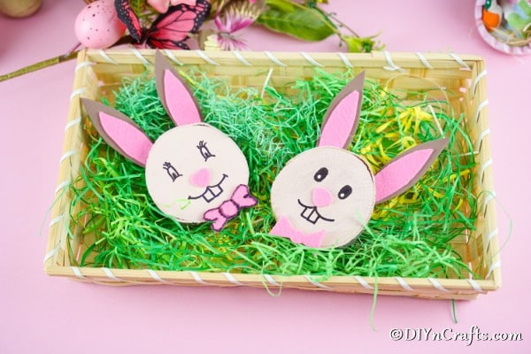 Wood slice easter bunnies in fake grass