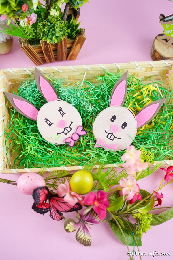 Wood slice bunnies in basket with fake grass