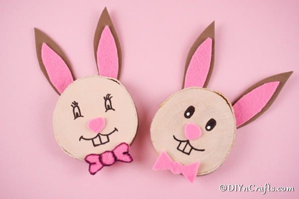 Wood slice easter bunnies on pink surface