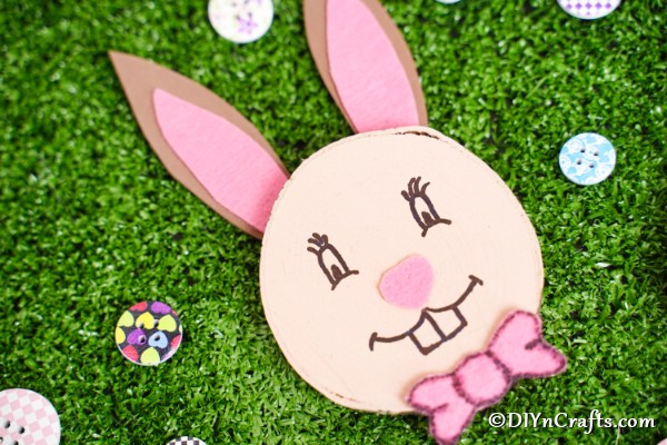 Wood slice easter bunny on fake grass