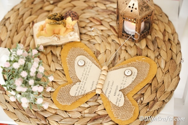 Burlap butterfly on woven mat