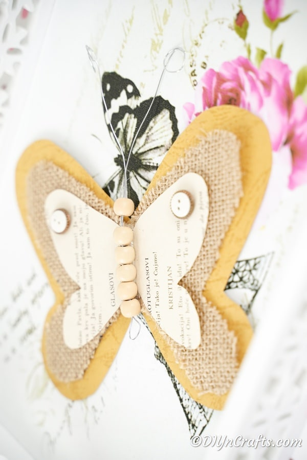 Burlap butterfly on butterfly print paper