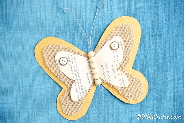 Burlap butterfly on blue surface