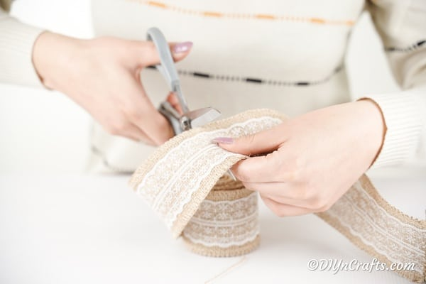 Cutting a strip of burlap