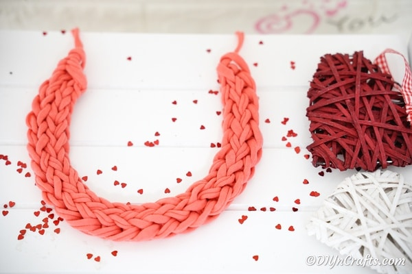 Yarn necklace on white table