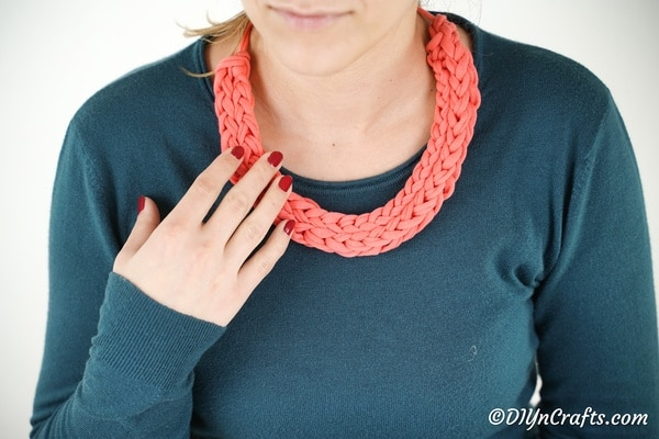 Woman wearing pink finger knit necklace
