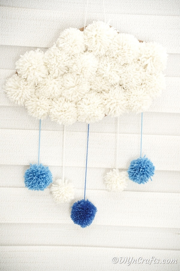Pom Pom cloud against brick wall