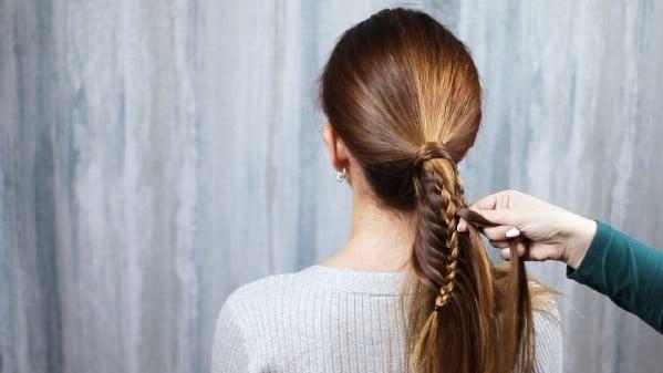 Brunette hair being braided