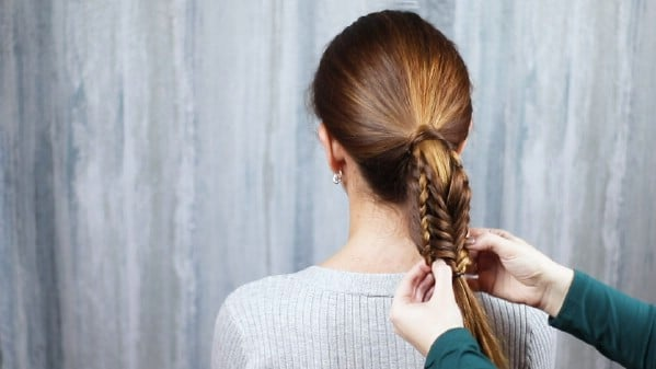 Tying ponytail in place
