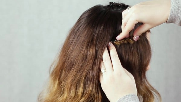 Pinning braid in place under hair