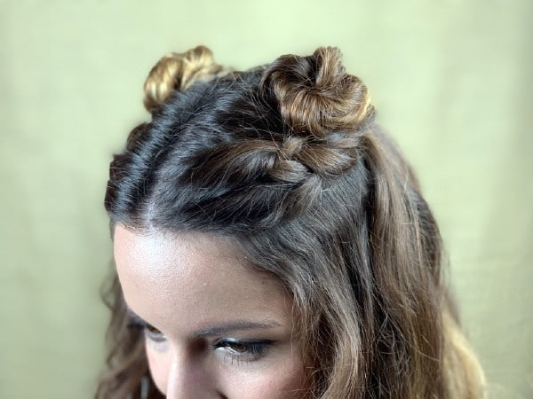 Close up of braided top knot hairstyle