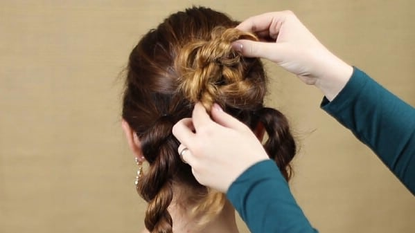 Twisting braid up to pin for bun