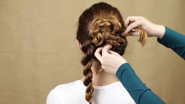 Twisting braid up to create bun