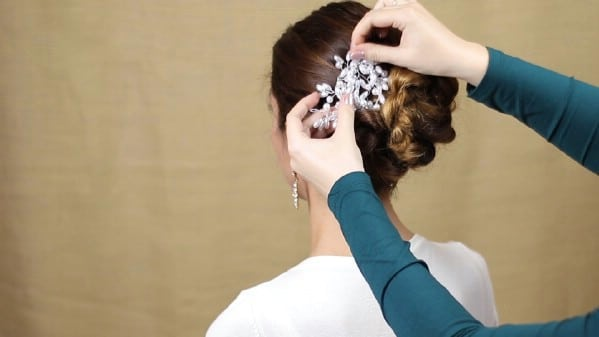 Adding beads to hair bun