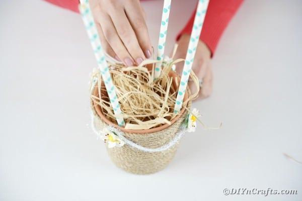 Adding hay to basket