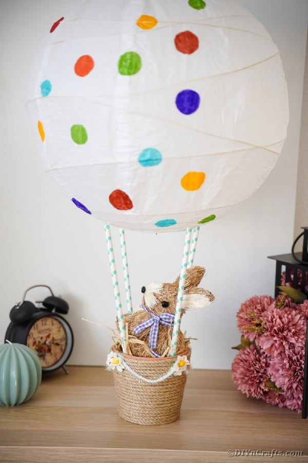 Easter hot air balloon next to flowers