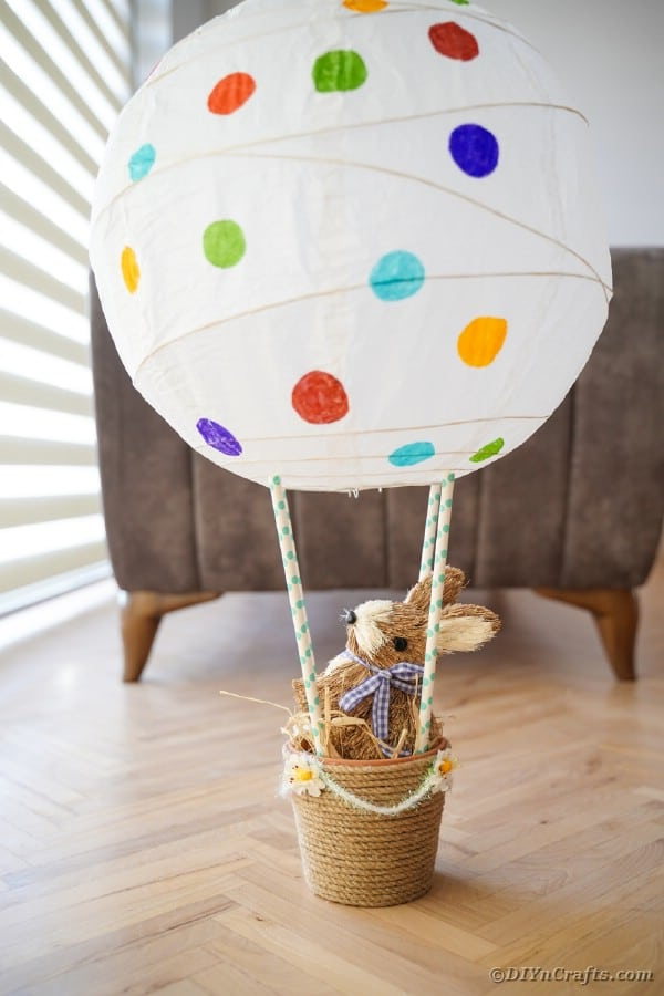 Easter hot air balloon on floor by chair