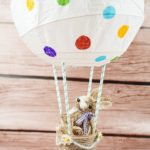 Easter bunny balloon craft on wooden table