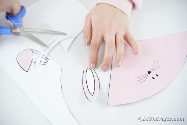 Cutting ears from paper for bunny