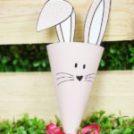 Paper bunny cone in front of wood box