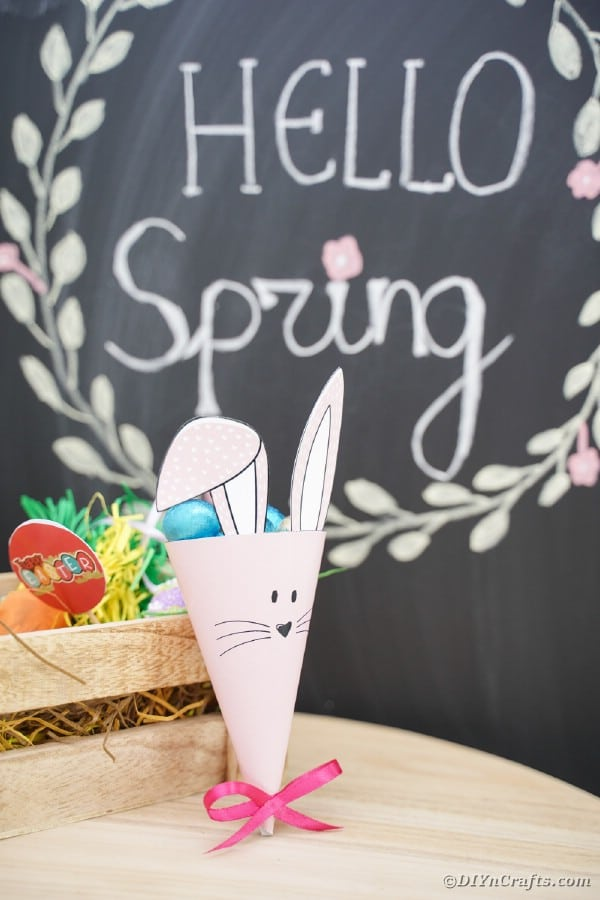 Easter bunny candy holder on table by chalkboard