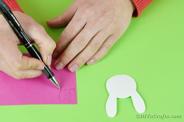 Cutting bunny ears out of pink paper