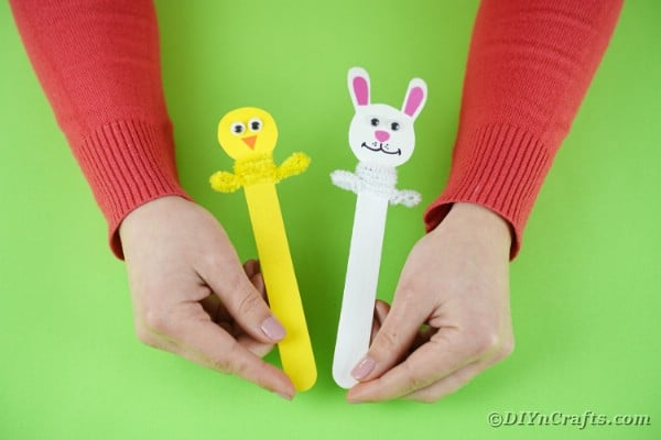 Woman holding easter bookmarks
