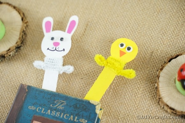Bunny and chicken bookmarks in book on burlap