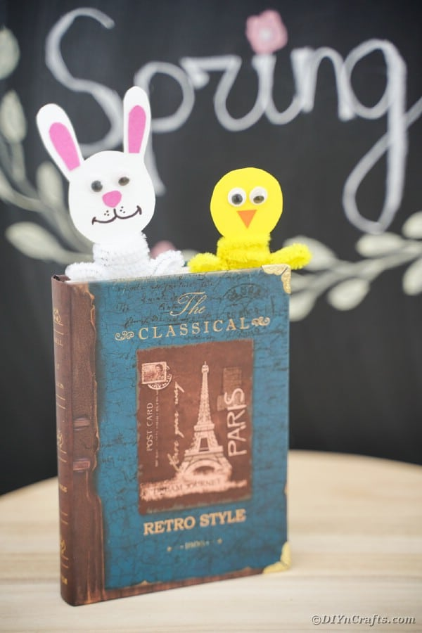 Easter bookmarks in book in front of chalkboard