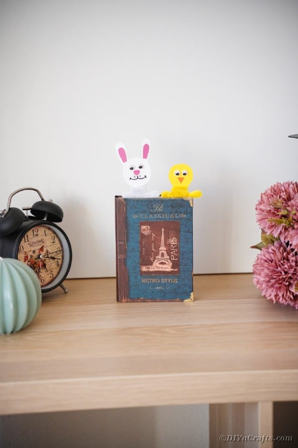 Easter bookmarks in a book on table