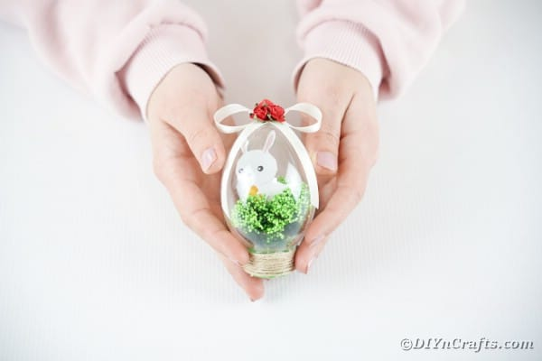 Woman holding bunny in Easter egg craft