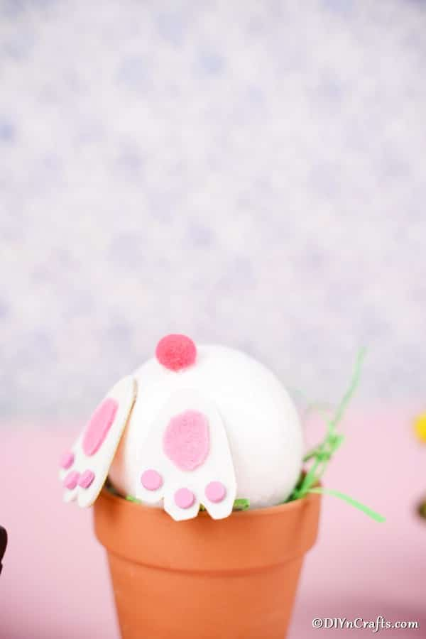 Easter bunny flower pot craft in front of pink background