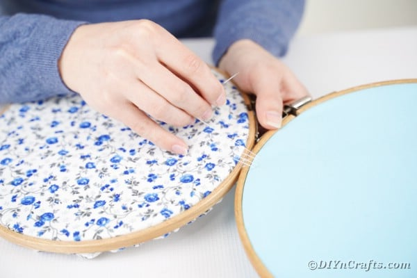 Securing embroidery hoop